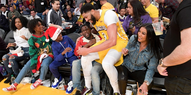 Anthony Davis of the Los Angeles Lakers lands on Kevin Hart at the end of the first half of a basketball game between the Los Angeles Lakers and the Los Angeles Clippers at Staples Center on December 25, 2019 in Los Angeles, California. (Photo by Allen Berezovsky/Getty Images)