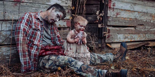 In honor ofthe spookiest day of the year, one Alabama mom staged a frightfulHalloween-inspired photo shoot, depicting her husband and 11-month-old daughter as zombies, that immediately went viral online. (Tifflynn Photography)