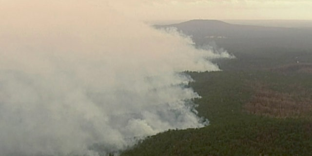 In this image made from video, an aerial view shows wildfires in the forests of Gippsland, Victoria, Australia, Dec. 31, 2019.
