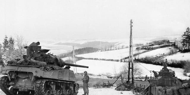 In this Jan. 6, 1945 file photo, American tanks wait on the snowy slopes in Bastogne, Belgium during the Battle of the Bulge.