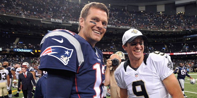 FILE - In this Aug. 22, 2015, file photo, New England Patriots quarterback Tom Brady (12) and New Orleans Saints quarterback Drew Brees (9) greet each other after an NFL preseason football game in New Orleans. (AP Photo/Bill Feig. File)