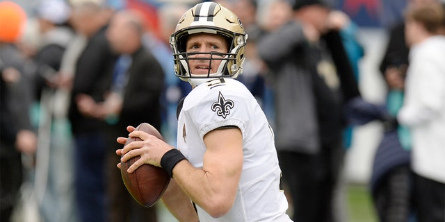 In this Dec. 22, 2019, file photo, New Orleans Saints quarterback Drew Brees warms up for the team's NFL football game against the Tennessee Titans in Nashville, Tenn. (AP Photo/Mark Zaleski, File)