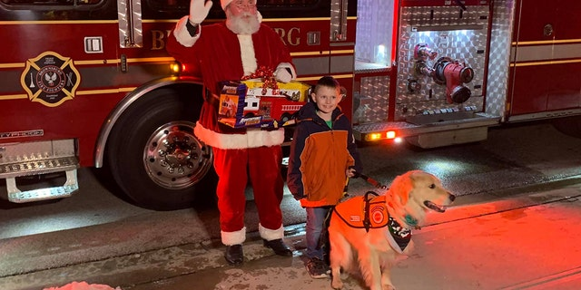 The Brownsburg Fire Territory and Santa visited 8-year-old Tyler Burkhart in Indiana on Monday night.