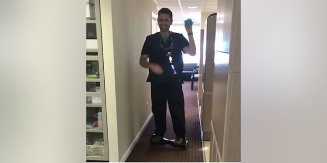 Alaska dentist Seth Lookhart in a video riding a hoverboard.