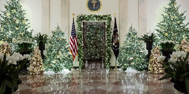 The official White House Christmas tree is decorated in the Blue Room seen through the Cross Hall, during the 2019 Christmas preview at the White House, Monday, Dec. 2, 2019, in Washington. [AP Photo/Alex Brandon)
