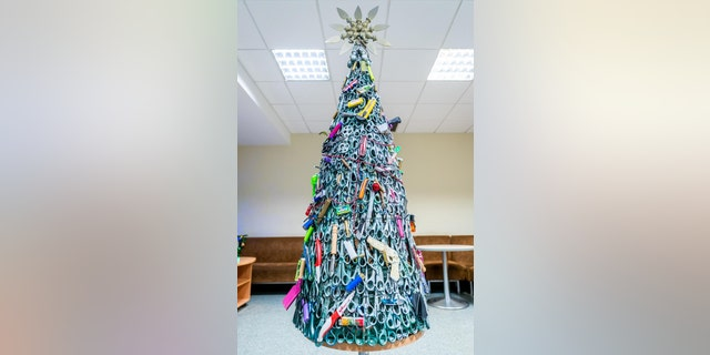 Vilnius Airport shared an image of the tree on LinkedIn, explaining that it was made exclusively using prohibited items that were taken from passengers' carry-on luggage during security screening.