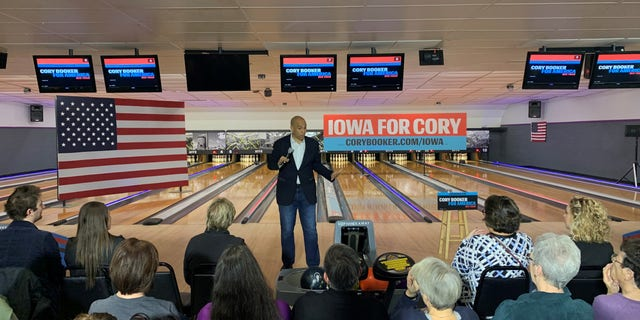Democratic presidential candidate Sen. Cory Booker of New Jersey campaigns at a bowling alley in Adel, Iowa on Dec. 19, 2019