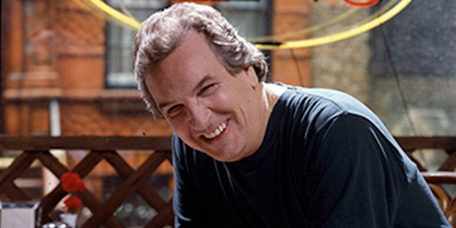 Portrait of American actor Danny Aiello, in costume (as 'Sal') smiles as he poses on the set of the film 'Do the Right Thing' (directed by Spike Lee), New York, 1989.