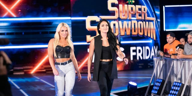 "Mandy Rose, left, and Sonya Deville enter the ""SmackDown"" ring."
