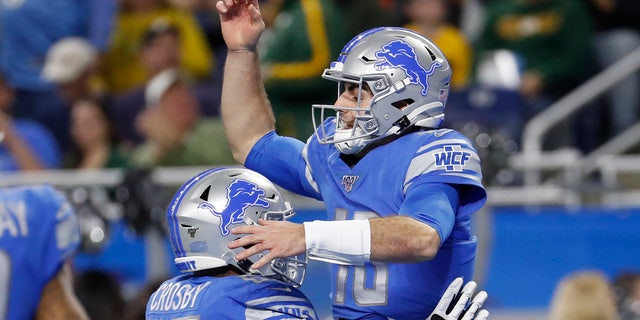 Detroit Lions quarterback David Blough is lifted by teammate offensive tackle Tyrell Crosby (65) after scoring on a 19-yard reception during the first half of an NFL football game against the Green Bay Packers, Sunday, Dec. 29, 2019, in Detroit. (Associated Press)