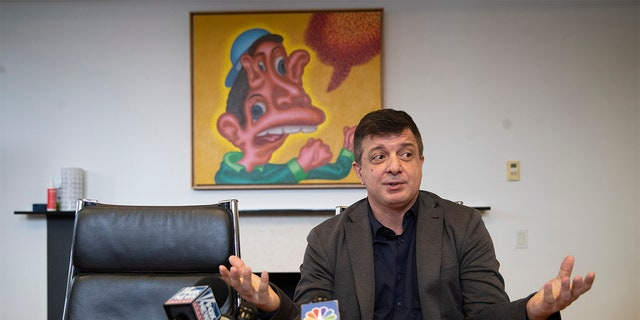 """Artist David Datuna speaks to reporters during a news conference, Monday, Dec. 9, 2019, in New York. Datuna ate """"Comedian,"""" a spotty banana duct-taped to a wall by artist Maurizio Cattelan, at Art Basel Miami Saturday, Dec. 7, 2019. (AP Photo/Mary Altaffer)"""