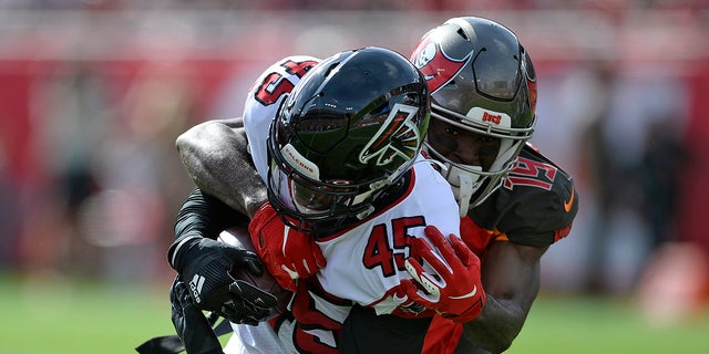 Atlanta Falcons linebacker Deion Jones (45) is stopped by Tampa Bay Buccaneers wide receiver Breshad Perriman (19) after Jones recovered a fumble by running back Ronald Jones II (27) during the first half of an NFL football game Sunday, Dec. 29, 2019, in Tampa, Fla. (AP Photo/Jason Behnken)
