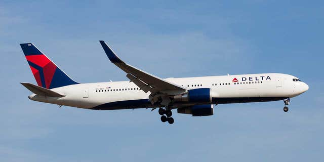 "Delta has launched an investigation into the incident confirming that the slide that fell was an ""inflatable over-wing slide."""