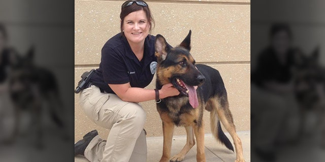 The Sedgwick County Sheriff's Office posted this photo of Deputy Sarah Sinnett and her new police dog Nimitz on Facebook in 2014.