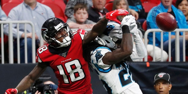 Atlanta Falcons wide receiver Calvin Ridley (18) misses a catch against Carolina Panthers cornerback Donte Jackson (26) during the first half of a December 2019 game in Atlanta.