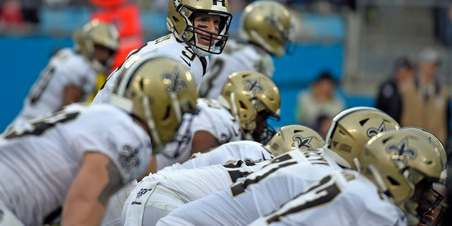 New Orleans Saints quarterback Drew Brees (9) lines for a play against the Carolina Panthers during the first half of an NFL football game in Charlotte, N.C., Sunday, Dec. 29, 2019. (AP Photo/Mike McCarn)
