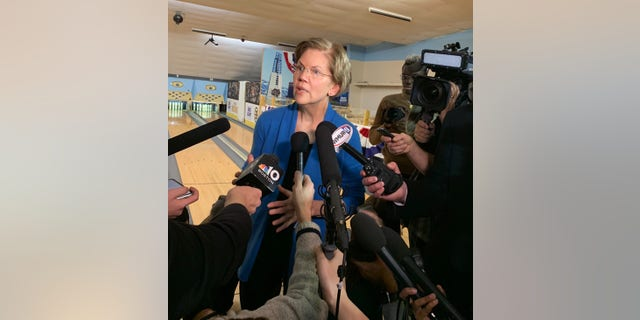 Democratic presidential candidate Sen. Elizabeth Warren of Massachusetts speaks with reporters after a town hall at a bowling alley in Peterborough, N.H., on Dec. 6, 2019