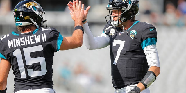 Gardner Minshew #15 of the Jacksonville Jaguars and Nick Foles #7 warm up before the start of a game against the Tampa Bay Buccaneers. (Photo by James Gilbert/Getty Images)