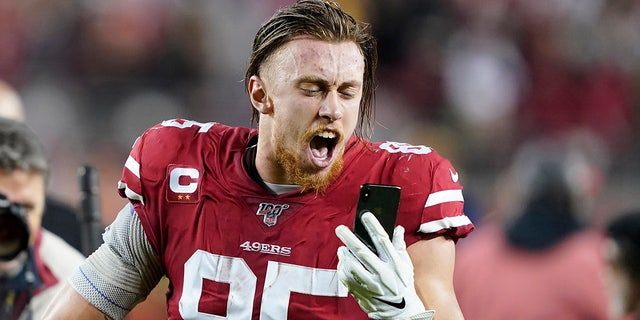 San Francisco 49ers tight end George Kittle yells into a phone while celebrating after the 49ers defeated the Los Angeles Rams in an NFL football game in Santa Clara, Calif., Saturday, Dec. 21, 2019. (AP Photo/Tony Avelar)