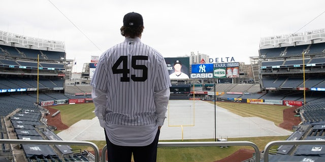 Gerrit Cole poses at Yankee Stadium as the newest New York Yankees player is introduced during a baseball media availability, Wednesday, Dec. 18, 2019 in New York. The pitcher agreed to a 9-year $324 million contract.