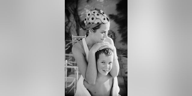 Princess Grace of Kelly relaxing with Prince Albert, then 9.