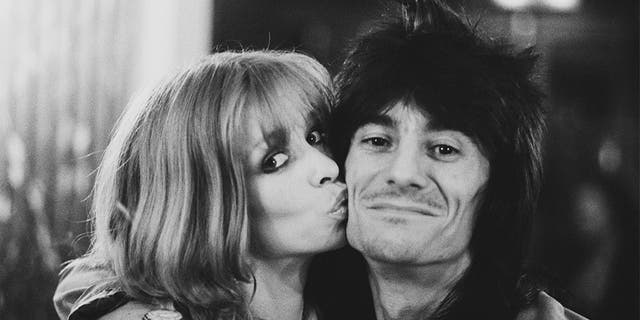 English rock musician, songwriter, multi-instrumentalist, artist, author Ronnie Wood of rock band The Rolling Stones with his partner Jo, UK, 26th July 1979.