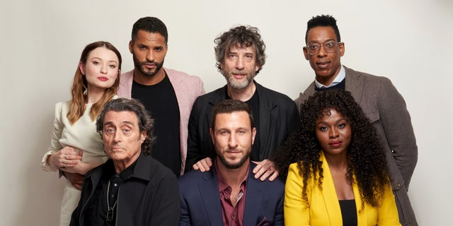 """The cast of """"American Gods."""" Counter-clockwise from the left: Emily Browning, Ian McShane, Ricky Whittle, Neil Gaiman, Pablo Schreiber, Orlando Jones, and Yetide Badakia. (Photo by Corey Nickols/Getty Images)"""
