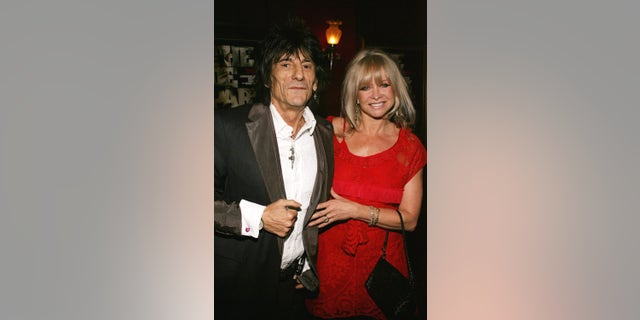 """Ron Wood with his wife Jo Wood during """"The Departed"""" New York Premiere at Ziegfeld Theater in New York, NY, United States."""