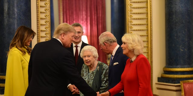 Queen Elizabeth II, Prince Charles and Duchess Camilla welcome Donald and Melania Trump to Buckingham Palace. Her Majesty Queen Elizabeth II hosted the reception for NATO Leaders to mark 70 years of the NATO Alliance. (Photo by Geoff Pugh - WPA Pool/Getty Images)