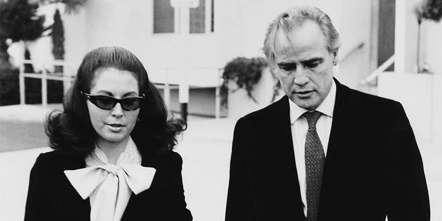 American actor Marlon Brando (1924 - 2004) leaves the Santa Monica courthouse with his attorney Judy Gilbert, during a legal battle with his wife, Anna Kashfi for custody of their son Christopher, 13th March 1972.