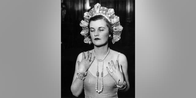 1930: The Duchess of Argyll at a dress rehearsal for the Jewels of Empire Ball at Brook House in Park Lane.