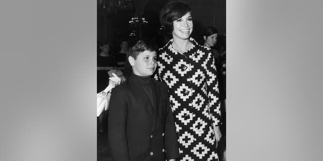 Mary Tyler Moore puts her arm around her son, Richard Meeker Jr.