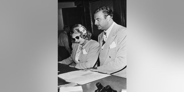 """(Original Caption) Mrs. """"Bogie"""" isn't anymore...Mrs. Humphrey Bogart, shown with attorney Paul Ralli, was awarded a divorce from actor Humphrey Bogart. Mrs. Bogart is Mayo Methot of the movies. Actress Lauren Bacall and Bogart have announced that they will soon be wed."""