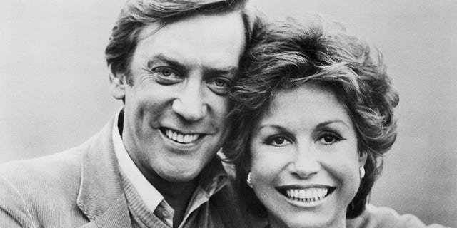 "Donald Sutherland and Mary Tyler Moore are shown in a scene from their movie, ""Ordinary People"" directed by Robert Redford and released by Paramount Pictures. Sutherland and Moore's characters attempt to pick up the pieces of their shattered life after a major tragedy by planning a holiday trip to London."