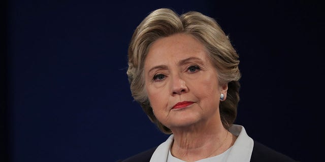 Democratic presidential nominee former Secretary of State Hillary Clinton listens to a question during the town hall debate at Washington University on October 9, 2016 in St Louis, Missouri. (Photo by Chip Somodevilla/Getty Images)