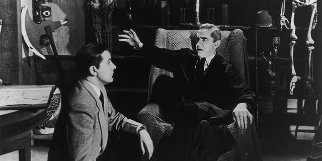 Wood talks to actor Bela Lugosi on the set of the film