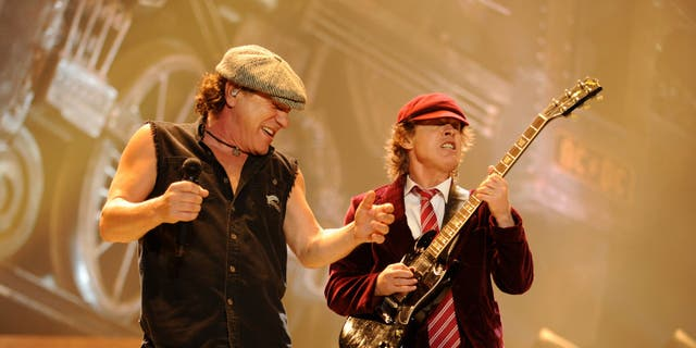 "Brian Johnson and Angus Young of AC/DC perform during their ""Black Ice"" Tour Opener on October 28, 2008. (Kevin Mazur/Getty Images)"