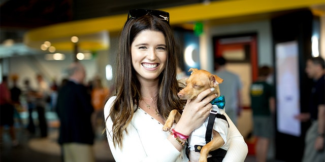 Author Katherine Schwarzenegger poses for a picture with dog Tuna at the Grand Opening Celebration For The Wallis Annenberg PetSpace at the Wallis Annenberg PetSpace on June 24, 2017, in Playa Vista, California.