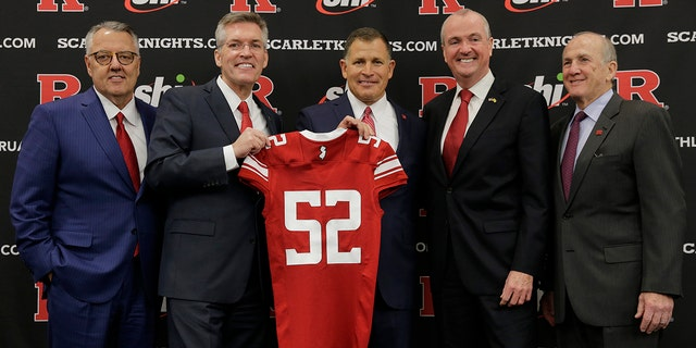 New Rutgers NCAA college football conduct manager Greg Schiano, center, poses for a design with Greg Brown, authority of a Committee on Intercollegiate Athletics, left, Rutgers jaunty executive Pat Hobbs, second from left, New Jersey Gov. Phil Murphy, second from right, and Rutgers boss Robert Barchi, right, after an rudimentary news discussion in Piscataway, N.J., Wednesday, Dec. 4, 2019. After an on-again, off-again courtship, Schiano is behind as Rutgers football coach. (AP Photo/Seth Wenig)