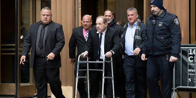 Harvey Weinstein, center, leaves court following a hearing in New York on Dec. 11.