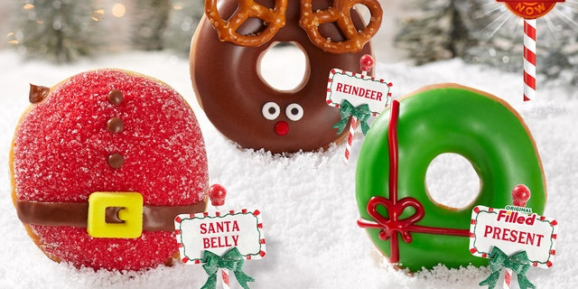 "Krispy Kreme's new Holiday Doughnut Collection includes a ""Santa Belly Doughnut"" with chocolate ""Kreme""-filling, a glazed ""Reindeer Doughnut"" with pretzel antlers, and a ""Present Doughnut"" filled with ""original Kreme."""