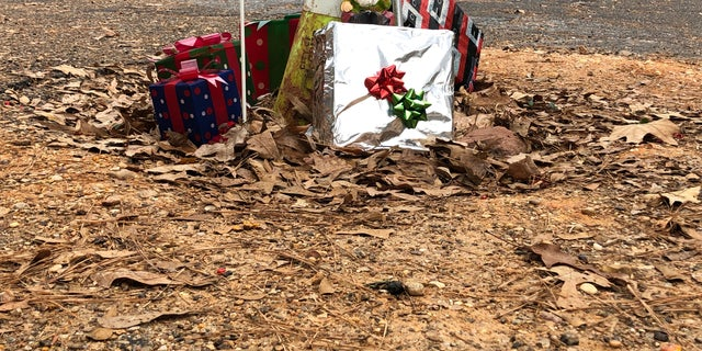 Presents underneath the makeshift Christmas tree in McComb, Mississippi. Residents placed the tree inside the pothole in the hopes of getting it fixed. (Fox News/Charles Watson)