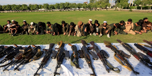 Islamic State militants who surrendered to the Afghan government are presented to media in Jalalabad, Nangarhar province, Afghanistan November 17, 2019. A Connecticut man is charged with attempting to travel to Syria to kill on behalf of the terror group. REUTERS/Parwiz