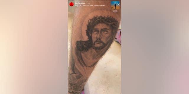 Justin Bieber's Jesus Christ tattoo on his left calf.