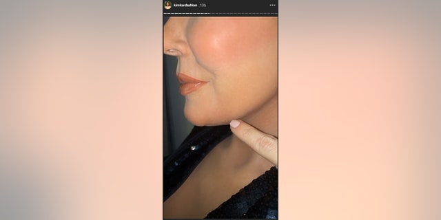 Kim Kardashian points out facial markings on mother Kris Jenner's wax replica.