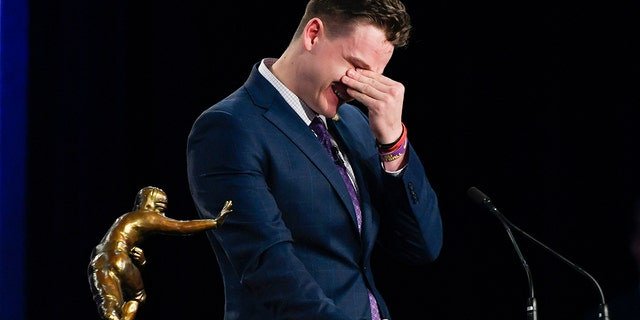 NCAA college football player, LSU quarterback Joe Burrow reacts while speaking after being awarded the Heisman Trophy, Saturday, Dec. 14, 2019, in New York. (Todd Van Emst/Pool Photo via AP)