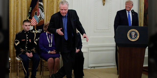 Jon Voight dances as President Donald Trump looks on during a National Medal of Arts and National Humanities Medal ceremony in the East Room of the White House, Thursday, Nov. 21, 2019, in Washington. (AP Photo/Alex Brandon)