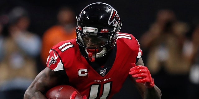 Atlanta Falcons wide receiver Julio Jones (11) runs by Jacksonville Jaguars cornerback A.J. Bouye (21) during the second half of an NFL football game, Sunday, Dec. 22, 2019, in Atlanta. (AP Photo/John Bazemore)