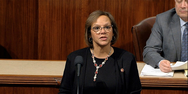Rep. Robin Kelly, D-Ill., speaks as the House of Representatives debates the articles of impeachment against President Donald Trump at the Capitol in Washington, Wednesday, Dec. 18, 2019. (House Television via AP)