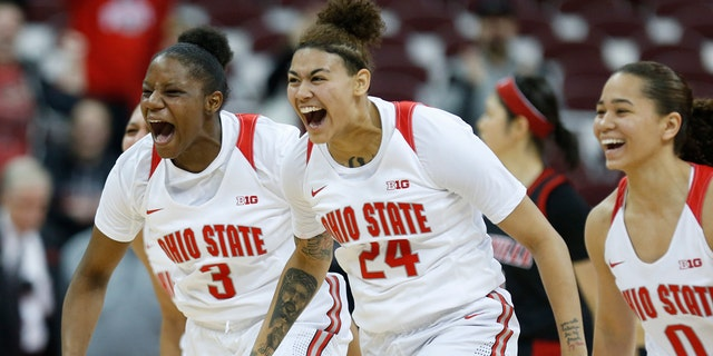 Ohio State guard Janai Crooms, left, guard Kierstan Bell and guard Madison Greene celebrate the team's win over Louisville in an NCAA college basketball game in Columbus, Ohio, Thursday, Dec. 5, 2019. (AP Photo/Paul Vernon)